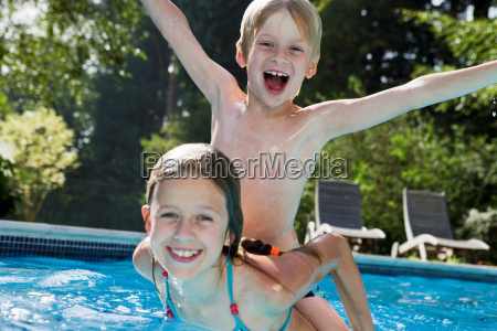 girl and boy in swimming pool