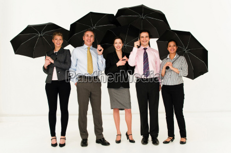 happy business people with umbrellas