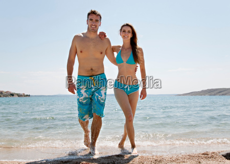 couple coming out of water at