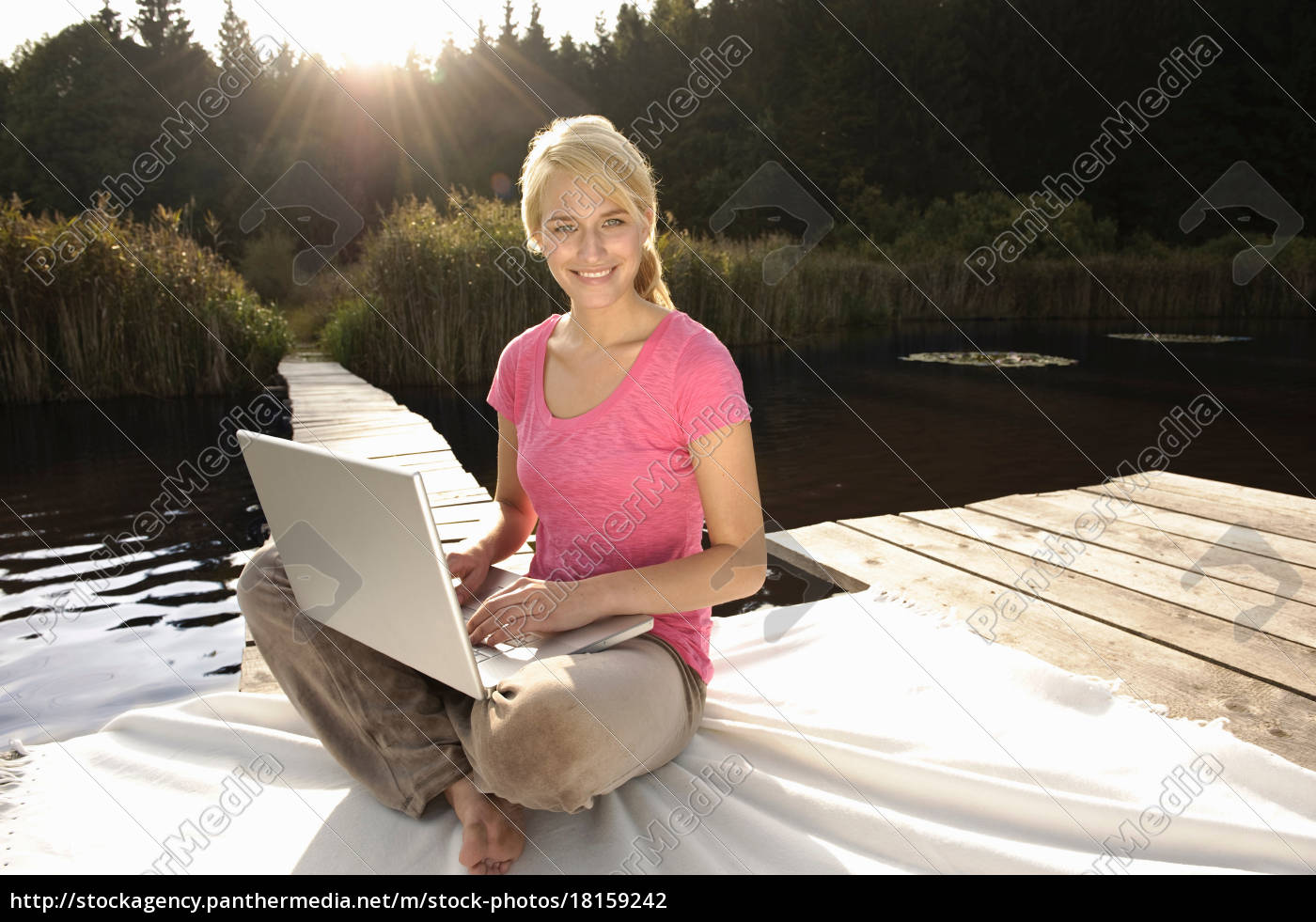 young, woman, using, laptop, , smiling - 18159242