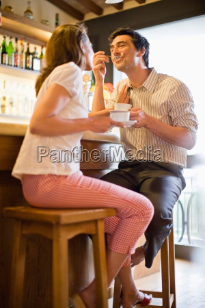 woman and man with coffee in