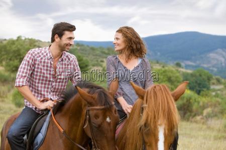 couple riding horses