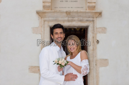bridal couple in front of church