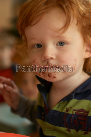 young boy with messy face