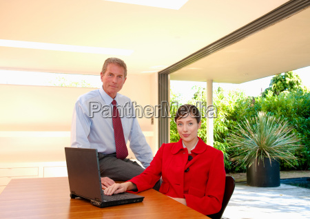 business couple in light office