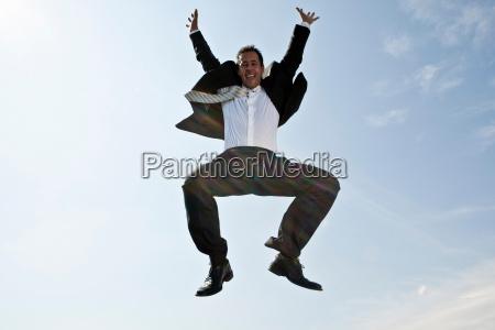 business man jumping
