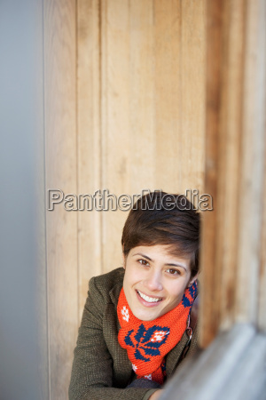 woman smiling in a hut in