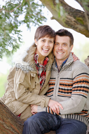 couple together sitting in a tree