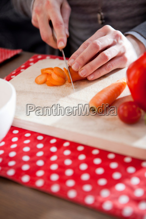 close up female hands cutting vegetable