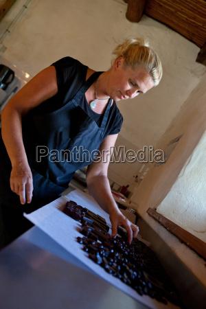 woman sorting praline