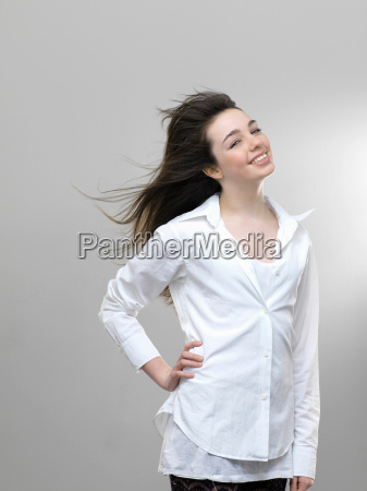 smiling girls hair blowing in wind