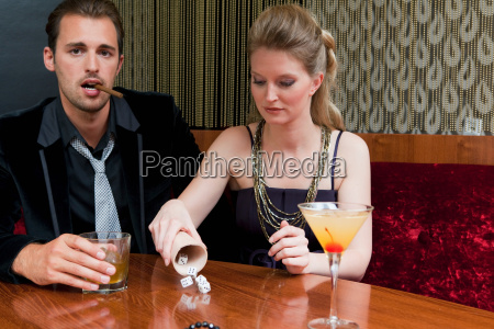 couple playing dice in bar