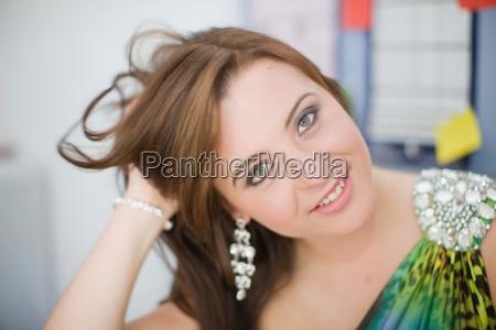 teenage girl wearing formal gown