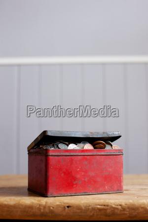 antique tin full of money on