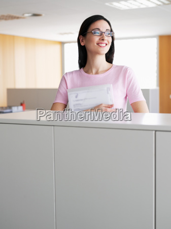 young businesswoman holding file