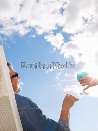 senior adult man relaxing in deckchair