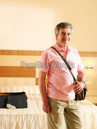 senior adult man standing in hotel