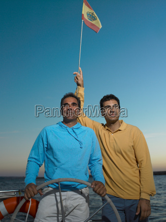 two mature men on yacht