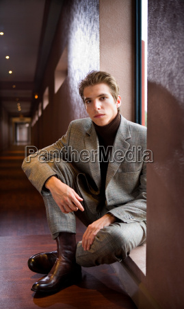 portrait young businessman sitting
