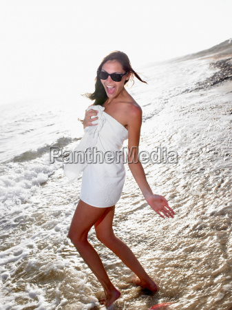woman standing in a towel at