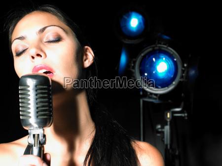 close up of woman singing