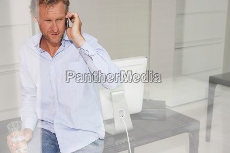 man in office on phone