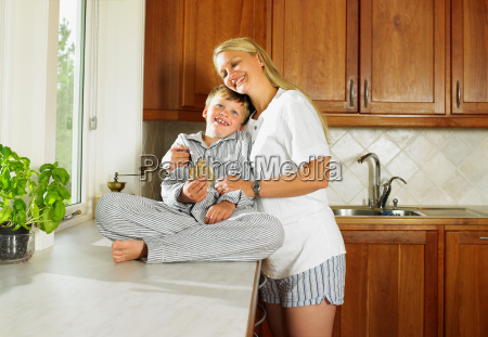 woman and young boy holding sandwich
