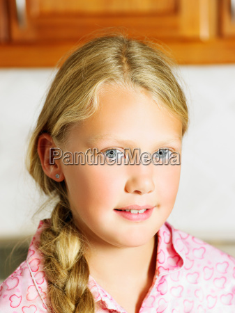 young girl in kitchen looking at