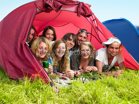 group of people lying in tent