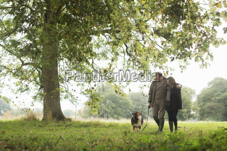 senior couple walking dog norfolk uk