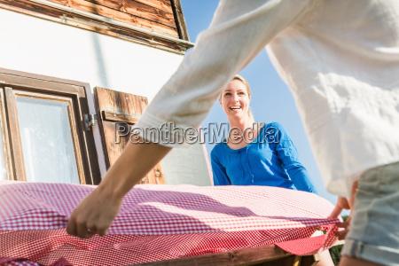 two women preparing table outside chalet