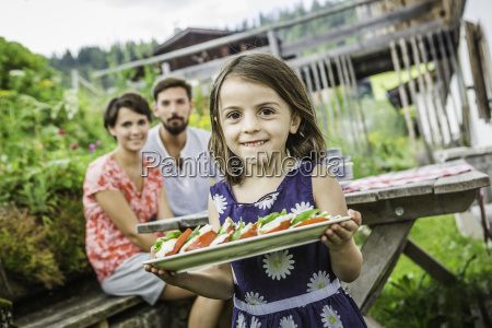 young family preparing picnic lunch tyrol