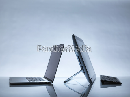 laptop and pc on desk