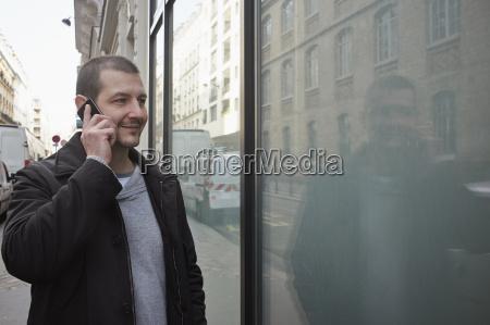 mid adult man talking on smartphone