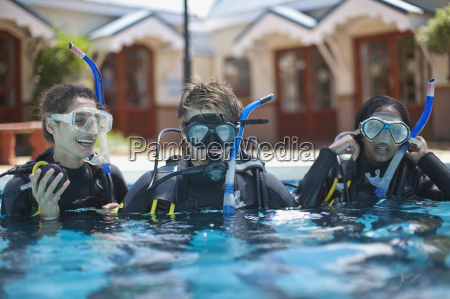 three young adult scuba divers training