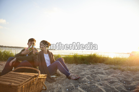 young couple picnicing on bournemouth beach