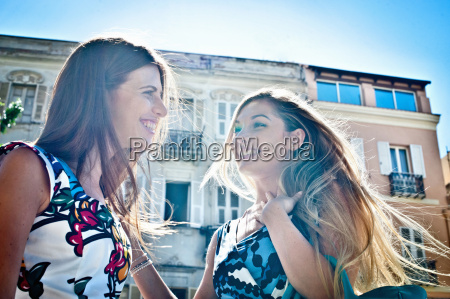 two young female friends chatting on