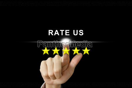 business hand pushing rate us on