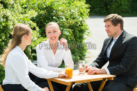 group of businesspeople having break
