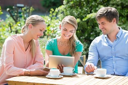 group of friends looking at digital