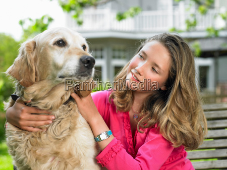 girl with dog in the garden