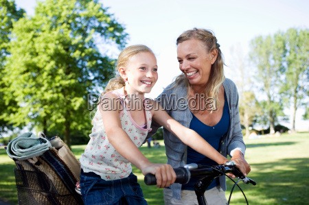 mother and daughter with bike