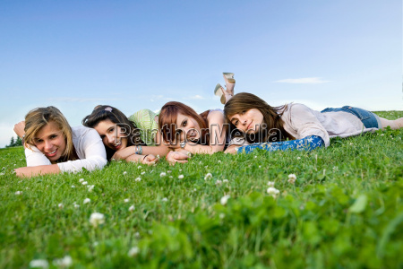 four teen girls portrait laying on