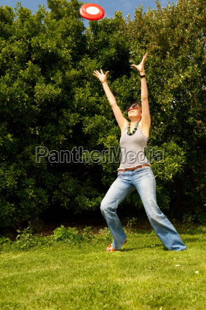 young woman trying to catch a