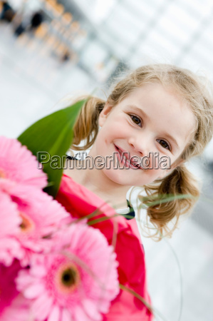 girl smiling holding flowers