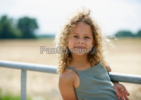 young girl on farm gate