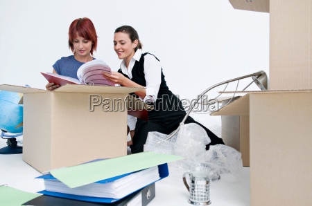 business colleagues unpack office boxes