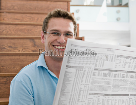 male reading the paper