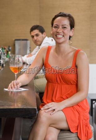 portrait of girl sitting at bar
