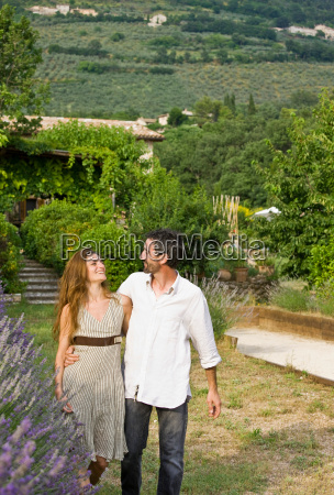portrait of couple walking in garden